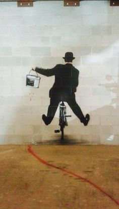 'Charlie Chaplin with Paint Bucket on a Bike', Street Art, Graffiti Art, Pop Art.