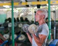 Senior Man Exercising In A Gym