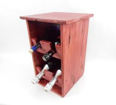 $69.00 - Hand crafted rustic pallet wood wine rack. Finished in a cherry red and urethane combination sealer. Holds four bottles of just about any size. Shelves are tilted downward to the front keep corks moist. Perfect size to set on a bar or on a kitchen counter... Click on the image above for more information or to buy from WileWood. Thank you for your interest!