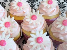Vanilla cupcakes frosted in french vanilla buttercream decorated with a white fondant daisy and wrapped in coordinating cupcake wrapper. Cupcakes Design, Fancy Cupcakes, Pretty Cupcakes, Sweet Cupcakes, Flower Cupcakes, Elegant Cupcakes, Amazing Cupcakes, First Birthday Cupcakes, Birthday Cake Girls