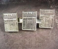 This is a quite unique set of cufflinks and tie clip. It depicts a miniature newspaper reminding us of the days when they yelled READ ALL ABOUT IT to make their sale. Now a days we can TELL ALL ABOUT IT ...What a great idea to give as a gift to a newspaper editor or columnist.The paper is also well known for a mistake it made during the 1948 presidential election. At that time, much of its composing room staff was on strike, and early returns led the paper to believe that the Republican…