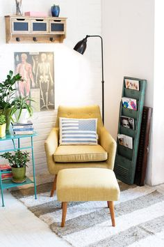 reading corner.  i like the eclectic accessories (even the A&P pic in the background!).