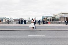 Relaxed City Wedding | London Bridge Portraits | Tea Length Lyn Ashworth Gown | Pink Peter Kaiser Shoes | Pink Colour Scheme & Wedding Flowers | Images by Miss Gen Photography | http://www.rockmywedding.co.uk/claire-john/