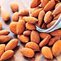 Snacking on almonds can help trim inches from your waist