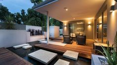 covered patio/terrace/deck dining area with lovely hard landscaping The Plantation