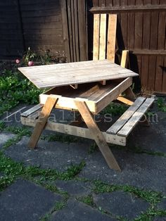 15 Unique Pallet Picnic Table | 101 Pallets-like the idea of the storage, probably could be done with seats too
