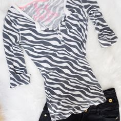 Zebra Henley Top 🔳 Zebra print 3/4 sleeve Henley top! This has a button up front and the sleeves fold up as well. Worn a handful of times but in perfect condition, no holes or stains. No trades 🚫 Kirra Tops