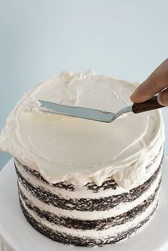 "Detailed ""how to"" frost a layered cake to look smooth and beautiful."