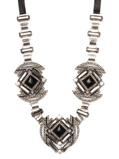 This gorgeous necklace has dusk-to-dawn party glamour written all over it. The super-sized silhouette makes this a bold statement style while the gold, glitzy crystals and bewitching black onyx are simply absolutely fabulous.