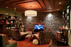 sport themed man cave ideas with shelves and lcd tv and wall hanging pictures and drum pendant lighting : Awesome Man Cave Ideas. decorate your man cave,man cave decor,man cave decor ideas,man cave design ideas,man cave designs Man Cave Living Room, Man Cave Wall, Man Cave Home Bar, Man Room, Man Cave Designs, Restaurant Design, Design Adidas, Man Cave Must Haves, Best Man Caves
