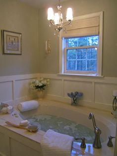 After: Spa-tacular Transformation in 5 Budget-Friendly Bathroom Makeovers from HGTV. LOVE the wood-work as the tub surround. Bathroom Spa, Bathroom Renos, Small Bathroom, Bathroom Ideas, Peach Bathroom, Bath Tub Decor Ideas, Wainscoting Bathroom, Vanity Bathroom, Budget Bathroom