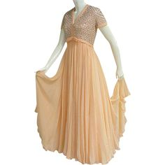 Lavish 1960s Peach Nectarine Silk Chiffon Evening Gown 50% off Until Saturday morning. Don't miss out.