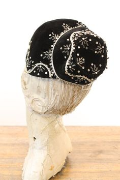 Lovely 1940s beaded bonnet! Done in a deep black velvet. Adorned with rhinestones and cylinder beads. Made in France♥ The name Baker is stitched on