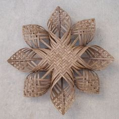 HISTORY: This woodland star design is the marriage of the century-old German star (later the Swedish advent star) with the Native American tradition of plait weaving, which has been around for millennia. DETAILS: This made to order star has a special closed weave center called the 2/2 twill, a standard plait weaving pattern. Constructed from quarter inch flat rattan, this star can be hung anywhere indoors. It also makes a great tree topper. © 2011 MEASUREMENTS: Approximately 16 (41cm) ...