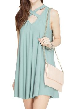 Seafoam sleeveless flowy dress with strappy v-neck detailing.  This dress is great for a wedding or graduation it's comfortable and breathable but made with a sturdy cotton and rayon mixture.  This dress fits true to size the model is shown in a small. Strappy Seafoam Dress by She  Sky. Clothing - Dresses - Wedding Wear Alabama