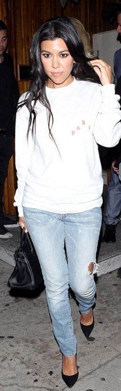 Kourtney Kardashian: Sweatshirt – Kanye West  Purse – Hermes  Jeans – J Brand  Shoes – Gianvito Rossi