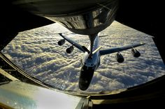 A U.S. Air Force KC-135 Stratotanker crew refuels a U.S. Air Force RC-135W Rivet Joint reconnaissance aircraft near Okinawa, Japan, Dec. 24, 2014. The KC-135 is assigned to the 909th Air Refueling Squadron. The RC-135W is assigned to the 82nd Intelligence Squadron. hires_141224-F-LH638-034B.jpg (1800×1200)