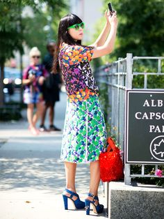 Susie Lau of Style Bubble in mixed prints and bright accessories
