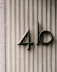 House number - Residence in Zurich by Atelier Abraha Achermann Signage Design, Lettering Design, Branding Design, Identity Branding, Corporate Design, Visual Identity, Environmental Graphic Design, Environmental Graphics, Helen Keller