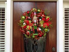 Whimsical Nutcracker and Poinsettia Wreath by HertasWreaths on Etsy