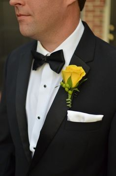 Simple yellow rose and green hypericum boutonniere with a swirled stem wrap.