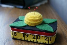 Darling pincushion made from an Altoids tin and felted sweater wool. Could make into a sewing kit or use to hold a gift card to JoAnn's.