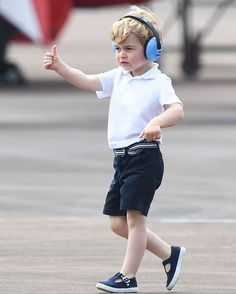 Prince George attended his first Royal Engagement in the UK today, a tour of the Royal International Air Tattoo at RAF Fairford. Let his adorable baby noise-canceling headphones and navy blue shoes help you bring this terrible week to a close @gettyimages