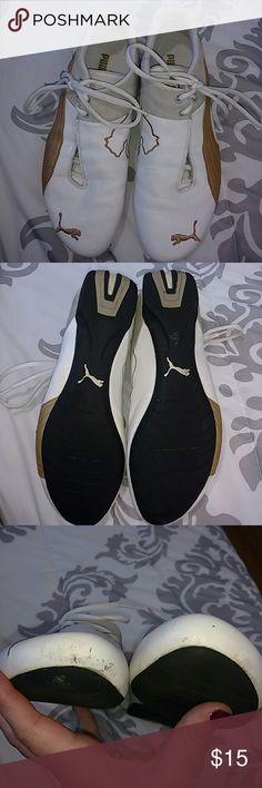 Puma Sneakers White and gold sneakers. Some scuff marks on both shoes. Puma Shoes Sneakers