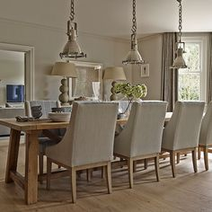 Neutral dining room with silver pendant lights, love the wide plank low sheen #hardwood #johnscreek #paintandflooring