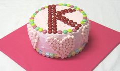 Want the full effect of a fancy birthday cake without having to fuss around with fondant icing? Try this easy birthday cake recipe that is decorated with the initial of your birthday child's name. Genius!
