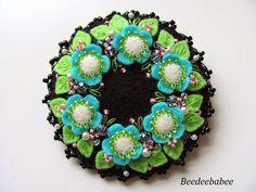 round green aqua pin