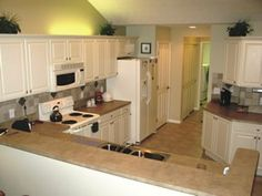 Bisque Appliances With Cabinets Light Floor