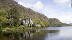 tKylemore Abbey in Connemara has been home to a community of Benedictine nuns since 1920. Originally a castle, the stunning lakeside dwelling was built by Mitchell and Margaret Henry from 1867 to 1871.