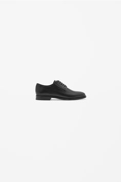 A classic style, these lace-up shoes are made from panels of smooth leather. With an asymmetric panel detail, they have leather insoles, anti-slip rubber inserts and neat topstitched edges. Black Leather Shoes, Black Shoes, Cos Stores, Contemporary Fashion, Lace Up Shoes, Shoe Collection, Smooth Leather, Fashion Brand, All Black Sneakers