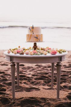 wedding cake table - photo by Alexandra Wallace http://ruffledblog.com/tranquil-bohemian-beach-wedding-inspiration