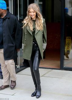Stunning style: Gigi Hadid showed off her enviably slender physique to the max when she left her apartment in New York's Tribeca district on Sunday wearing sexy stretch leather trousers