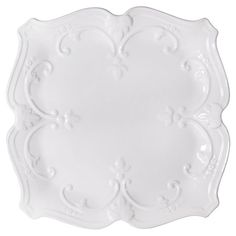 Add chic elegance to your dining room table with this charming ceramic dinner plate, showcasing raised scrolling detail in white.