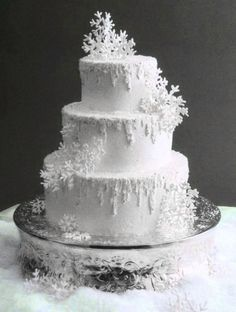 Snowflake Winter Wedding Cake maybe it the snowflakes the peacock blue and trimmed  in blue