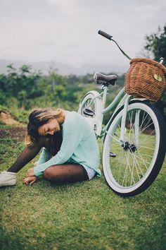 White bike style with black saddle. See more stylish women on bikes at melisinestudio.com and @melisinestudio on instagram.