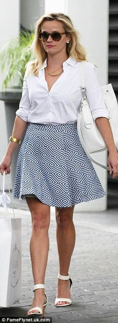 Taking care of business: The star accentuated her tanned pins with some summery white ankl...