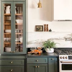 Yay or Nay: Moody Green Interiors – Green cabinets and brass hardware with soapstone counters. – - Yay or Nay: Moody Green Interiors - Green cabinets and brass hardware with soap. Updated Kitchen, New Kitchen, Kitchen Dining, Eclectic Kitchen, Dining Room, Kitchen Layout, Tudor Kitchen, Quirky Kitchen, Kitchen Sinks