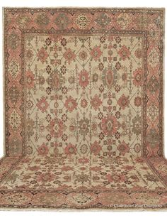 Sultanabad, 14ft 3in x 20ft 6in, Circa 1875. Bearing a patina as extraordinary as any antique Oriental carpet we have ever offered, this landmark 19th century Sultanabad carpet brings to life precisely those ideal qualities for which art carpets are so profoundly loved by rug connoisseurs and newcomers alike. Softened by over a century of age, warm natural colors of olive, khaki, and exquisite terra cotta take on an ethereal presence, blending effortlessly within a spacious allover…