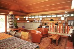 Buying a Frank Lloyd Wright original would be like trying to buy a priceless museum artifact.On Vashon you can live in a house inspired by his ideas for $374,000. Vashon Island, Usonian, Organic Architecture, Frank Lloyd Wright, Liquor Cabinet, Cottage, Museum, Cozy, House Design
