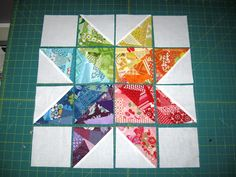 Happy Quilting: Scrappy Rainbow Star Tutorial. Each piece is made up of scraps sewn on a sq. of foundation fabric then make 1/2 sq. triangle blocks.