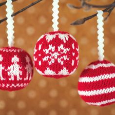 love these! they need to be knit tighter, and I'd just use red yarn for the loop, instead of the ric rac, but I like the idea of knit nordic ornaments.