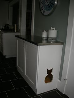 Cat cabinet - cat's food and water bowls are inside.....dog can no longer get to them.