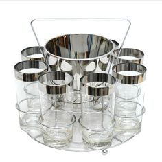 Perfect for your Mad Men cocktail party! Mercury band collins / highball  glasses & ice bucket caddy set. Mid Century Vintage.Available at Thehourshop.com