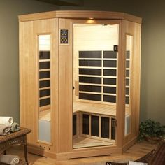 """Infrared saunas heat the body directly instead of heating the air around the person. These also do not get nearly as warm and heat to only 120 degrees Fahrenheit. Because of this, many people consider """"infrared saunas"""" as """"dry saunas"""". Basement Sauna, Sauna Room, Infared Sauna, Tall Cabinet Storage, Locker Storage, Indoor Sauna, Portable Sauna, Traditional Saunas, Sauna Design"""