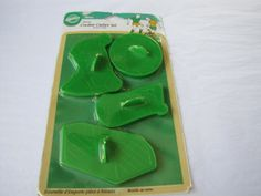 Wilton Sports Soccer Cookie Cutters Price: $32.99 Material - Plastic   Color - Green   Set Includes - Soccer Player, Goal Net, Soccerball, Cutter with words Goal   Year Made - 1996 click here to order http://www.cookiecuttersplus.com/content-product_info/product_id-2713/wilton_sports_soccer_cookie_cutters.html