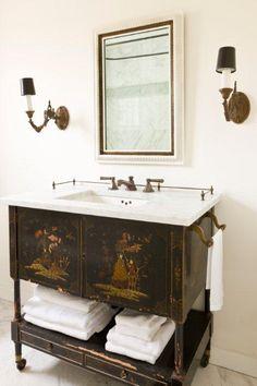 ... repurposed as a bathroom vanity - Marble countertop - Antique wall
